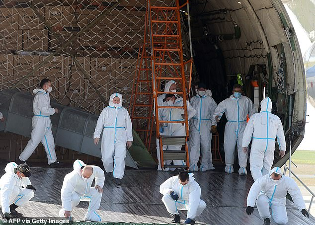 Operators unload Ukrainian plane from China to deliver 8.6 million face masks and 150 tonnes of sanitary equipment ordered by a private customer, at Paris-Vatry airport in Bussy Lettree today