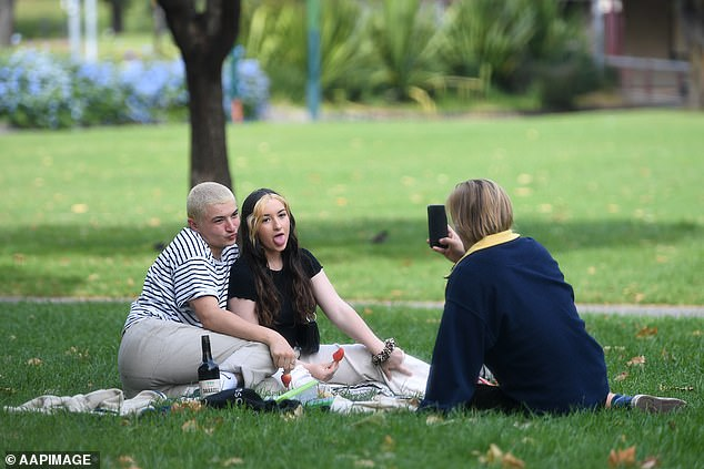 Picnics in the park could be back by June with the two-person rule relaxed to allow for small social gatherings like this one in Melbourne last month