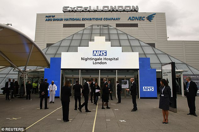 The exterior front of the new NHS Nightingale in London is pictured before it opens on April 7 with staff observing social distancing measures outside