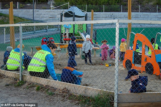 NORWAY: Children play in small groups in a kindergarten in Oslo Monday, when the youngest Norwegian children have been allowed to return to nursery schools