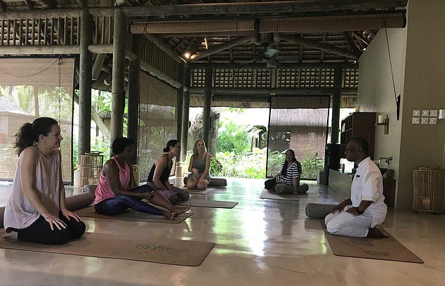 A teacher at the Mauritius Wellness festival is seen teaching a group the simple stretches to help eradicate aches and pains