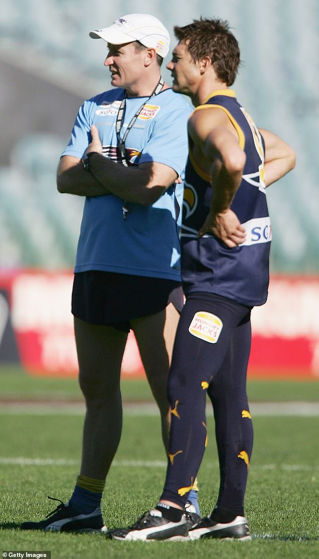 Eagles coach John Worsfold (left) and Captain Ben Cousins (right) look on during a West Coast Eagles training session at Subiaco Oval on May 23, 2005 in Perth