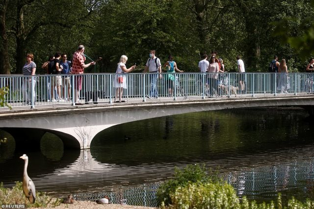 People also enjoyed the sunshine in St James's Park in London. Official rules say people should only be out for essential exercise once a day, to buy food or to go to work if they cannot work from home