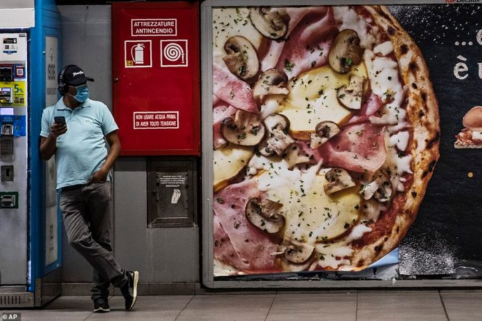 A man waits for a metro in Milan, previously at the center of the epidemic in Italy, after the lockout measures began to relax