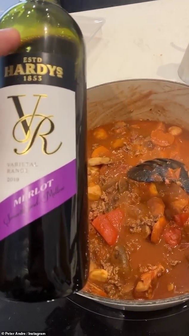 Desperate times: What a deflated Peter joked: `` I know, I'm on it '' and laughed at drinking red wine for the Bolognese instead