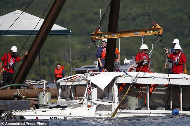 The duck boat that sank in Table Rock Lake near Branson, Mo is raised after it went down on the evening of July 19, 2018