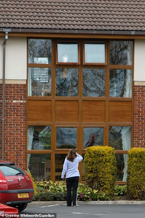 Woman greets mother from Stanley Park nursing home parking in County Durham - families prevented from visiting elderly parents unless dying to stop spread of coronavirus
