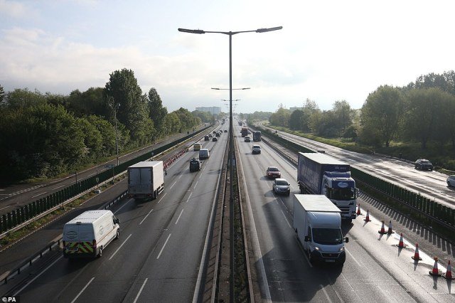 Traffic on the M4 motorway (left hand lane is inbound towards London) at Datchet near Windsor in Berkshire this morning