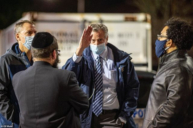 De Blasio, pictured Tuesday had traveled to personally shut down a Orthodox Jewish funeral in Williamsburg after images surfaced on social media of massive crowds gathered for a rabbi who died from coronavirus
