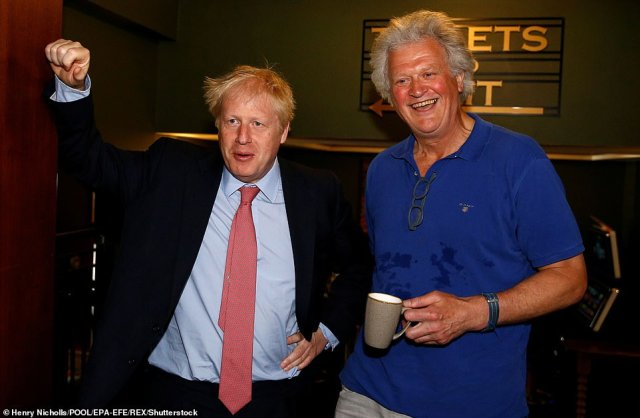 Wetherspoons Chairman Tim Martin (pictured with Prime Minister Boris Johnson in July last year) was forced to close all 900 pubs and furlough 40,000 workers when Britain went on lockdown on March 23
