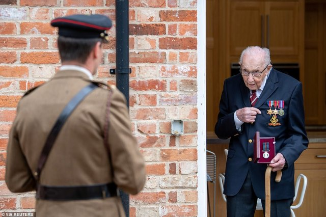 Newly-appointed Colonel Tom holds his Yorkshire Regiment Medal next to Lieutenant Colonel Thomas Miller at his home in Bedfordshire