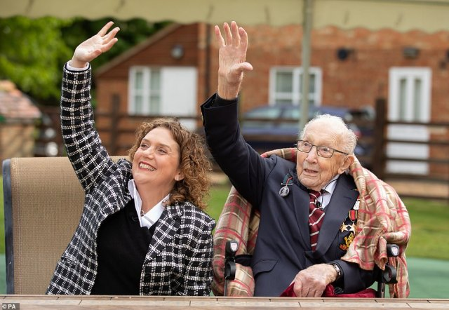 The newly-promoted Colonel, pictured with daughter Hannah, waved as the Hurricane and Spitfire flew above on his birthday this morning