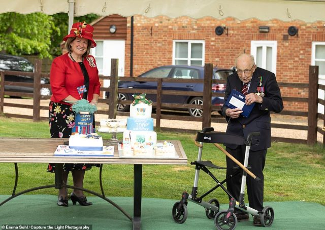 The Lord Lieutenant of Bedfordshire Helen Nellis, the Queen's representative in the county, delivered Captain Tom a birthday card from the monarch