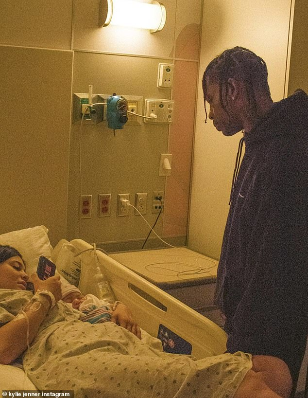 Intimate: On Thursday, the 22-year-old star posted a caption praising the father of her child, rapper Travis Scott, as well as sharing a series of unseen snaps.
