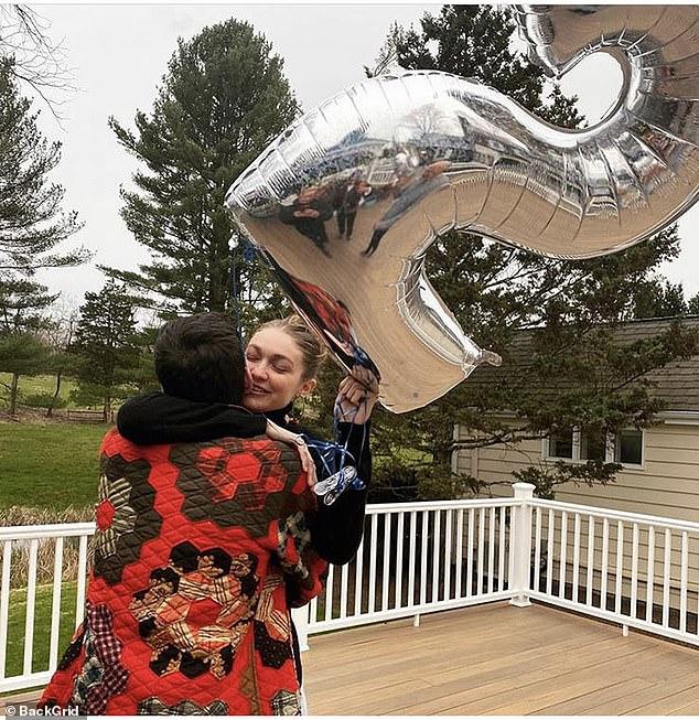 Birthday girl: Gigi kissed her boyfriend Zayn while celebrating her 25th birthday