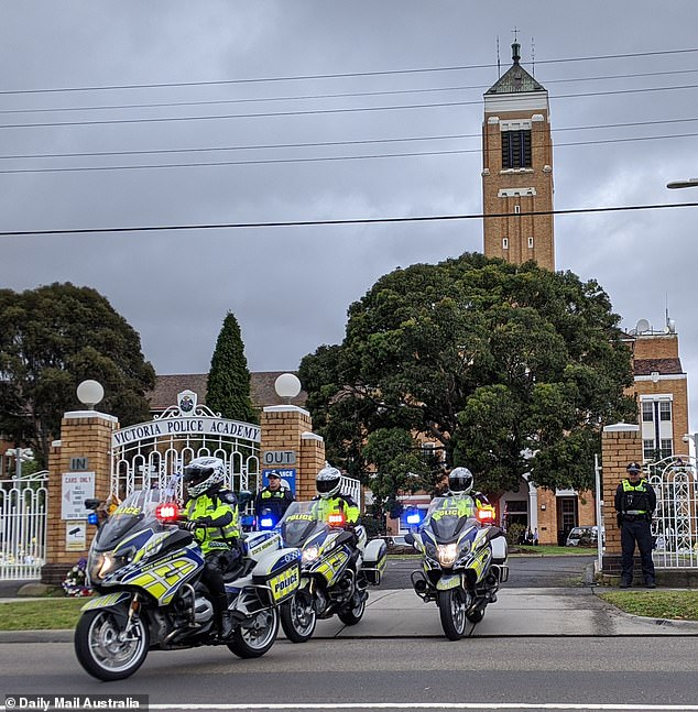 Police officers on motorcycles escort Senior Constable Kevin King to his final resting place on Friday