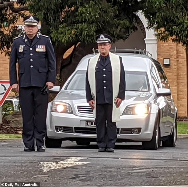Victoria Police Chief Commissioner Graham Ashton (left) and the police chaplin Jim Jung escort Senior Constable King out of the police academy. It was the second time they had to make the grim walk on Friday
