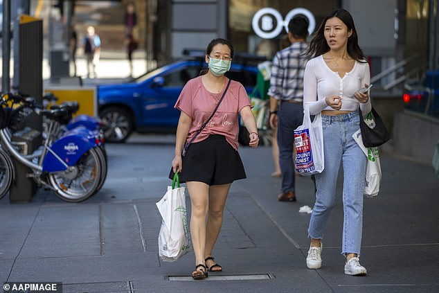A shopper wearing a mask in Brisbane on Friday. Australia's chief medical officer has said experts are recommending a slow stage-by-stage process of easing lockdown restrictions