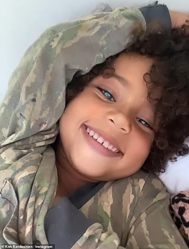 Beautiful boy: 39 years old posted a clip of his son, four, smiled and stuck out his tongue with his eyes glowing bright blue when he said: 'Look at that beautiful boy'