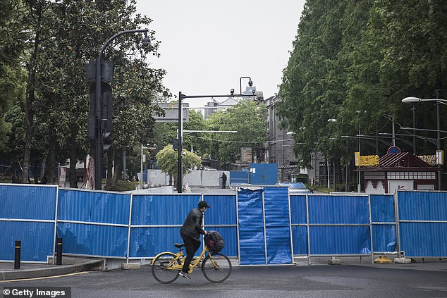 The city of Wuhan, where the virus was believed to be originated, was driven into a draconian lockdown on January 23, with no one allowed to enter or leave.A man riding a bike passes by the front a makeshift barricade built during the lockdown in Wuhan on April 21