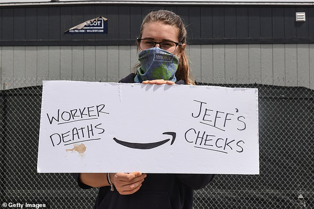 Protester Targets Amazon CEO Jeff Bezos With Sign