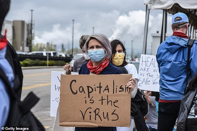 Protesters outside the Amazon Achievement Center on Staten Island, New York, are pictured Friday