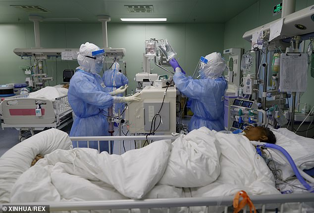 China has faced broad criticism over its handling of the virus amid a growing consensus that the government suppressed the scale of its early outbreak, thereby limiting the amount of time other nations had to prepare for their own. Medical workers are seen tending to a COVID-19 patient at a Chinese hospital in April