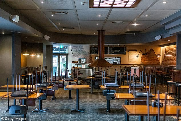Downloading the app could be key to getting bars and restaurants open again (pictured, an empty Melbourne pub on March 23)