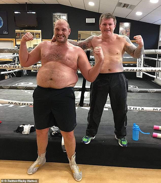 Hatton, seen here posing with Tyson Fury back in 2017, used to make jokes about the way he ballooned between fights
