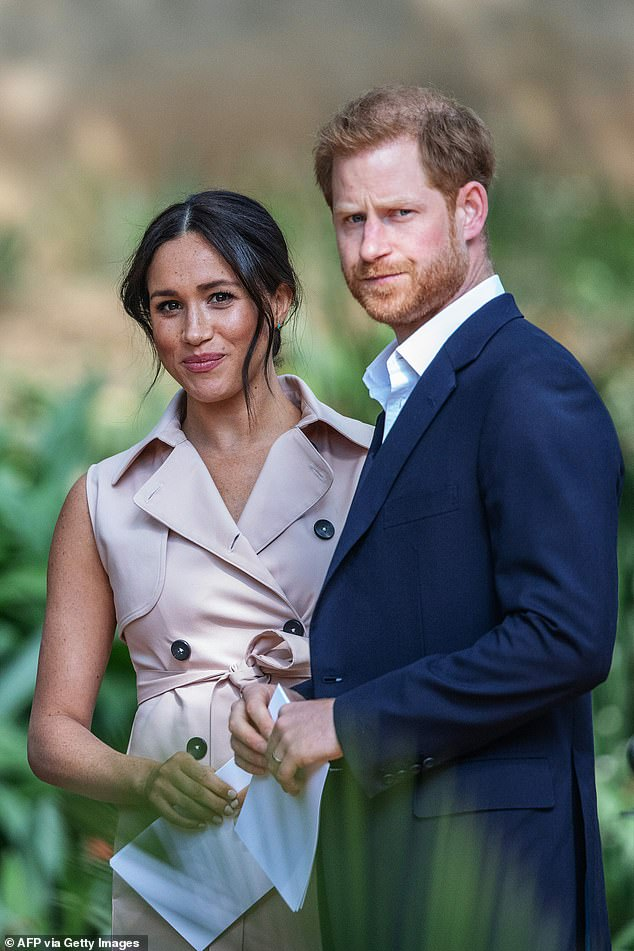 Good Morning Britain presenter once accused Meghan (pictured with Harry and son Archie) of 'abandoning' his own parents and separating Harry from the royal family