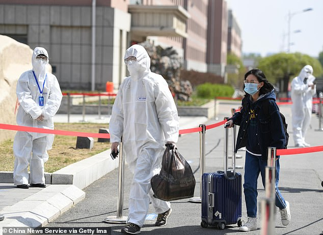 In northeast China's Jilin city of Shulan, thousands of residents are currently in detention after a group of infections is detected. Photo shows student wearing face mask arriving at Changchun University of Chinese Medicine in Jilin on May 7