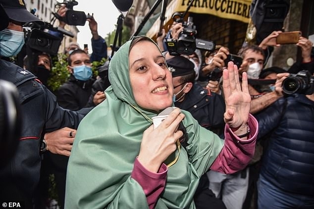 28268834 0 image a 4 1589219112915 Woman Kidnapped by Muslims : Many in Italy were anxiously awaiting this Sunday for the return of Silvia Romano, a twenty-five-year-old Italian national who was freed after being kidnapped in November 2018 in Chakama, (northern) Kenya by al-Shabaab jihadists.  Romano, a trained medical practitioner, was working as a volunteer for the Italian charity called Africa Milele when she was taken and accused by her captors for proselytizing Christianity in the Kenyan town.