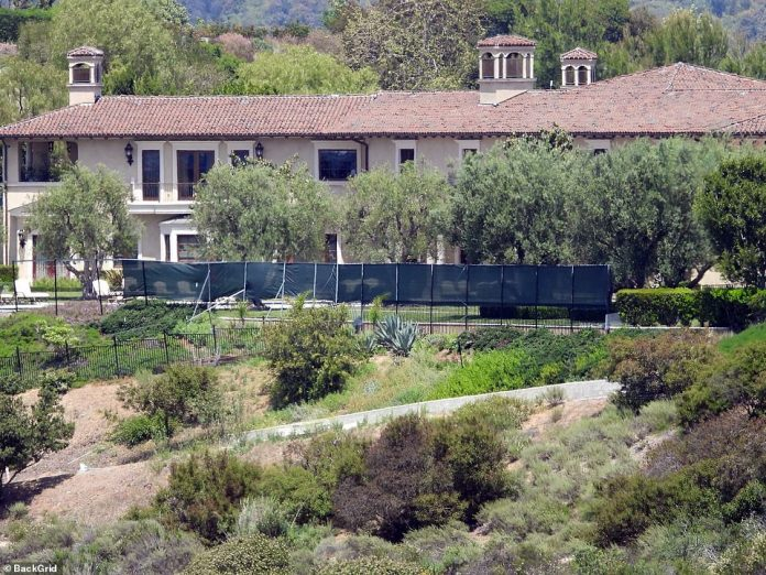 Prince Harry and Meghan Markle have erected screens around the mansion in the Beverly Hills area where they live