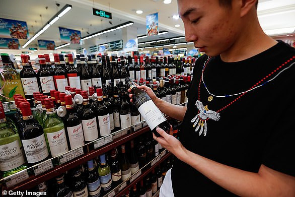 China is a key market for Australia's wine companies. Pictured: A customer selects an Aussie wine in Beijing