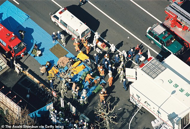 Rescue workers are pictured carrying survivors of the Tokyo subway attacks to emergency tents on March 20, 1995. The five attacks were timed to take place simultaneously