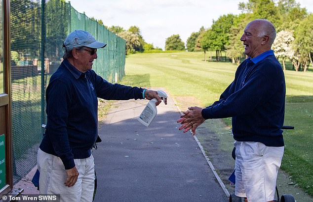 Filton Golf Club in Bristol opened for the first time since the lockdown and sees two men spraying each other on what appears to be a hand sanitizer