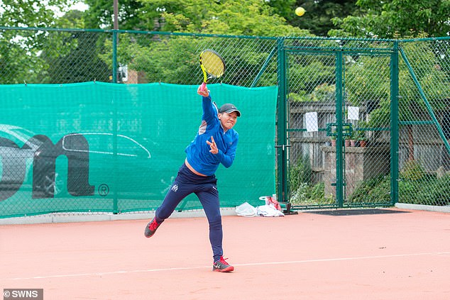 Christina San and Joshua Park are pictured playing tennis for the first time since the lock rules were relaxed at Westside Tennis Center, Wimbledon