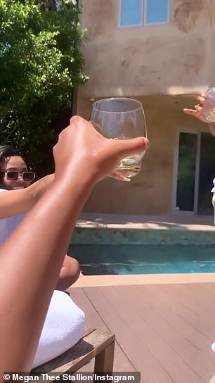 Cheers! Armed with sexy swimsuits, University of Southern Texas students enjoy drinks by the pool with the other two