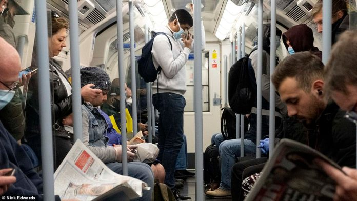 Meanwhile, on Britain's second day back to work, there were more sinister scenes on the subway and buses this morning as people crowded on limited services