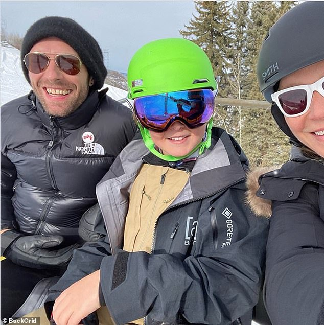 All together now! The couple remained close co-parents, often traveling together as a large blended family with Paltrow's husband Brad Falchuk and Martin Dakota Johnson's girlfriend