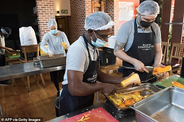 Volunteers cut and weigh butternuts as Woodstock Breweries make thousands of litres of vegetable soup to feed people made vulnerable under the lockdown in South Africa, as a result of the COVID-19 pandemic