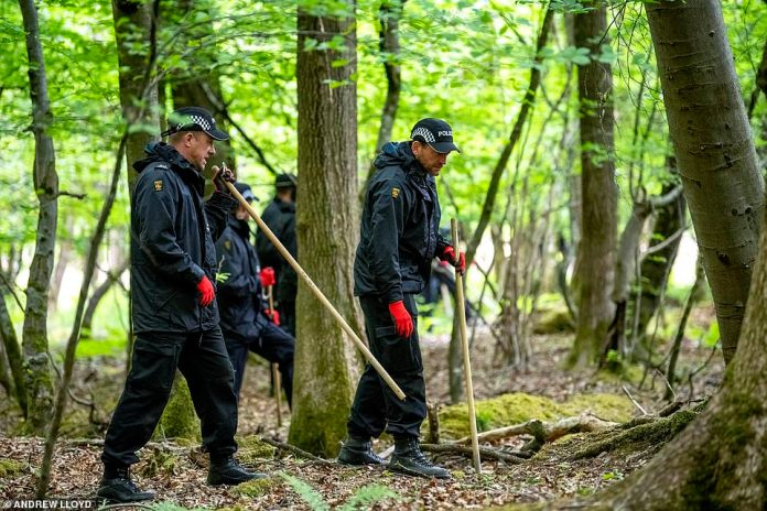 Police, photographed in a forest next to the Stowfield Quarry in the Forest of Dean, Gloucestershire, continue to search for clues today as the murder investigation enters its third full day. A roadblock was also in place along the A4136