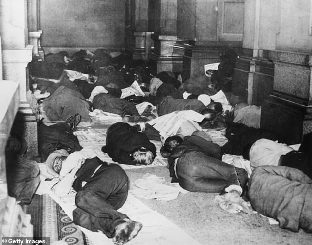 With COVID-19 crippling the United States economy, unemployment is at a staggering 14.7 per cent - a figure not seen since the height of the Great Depression in 1933 (1931 Philadelphia pictured)
