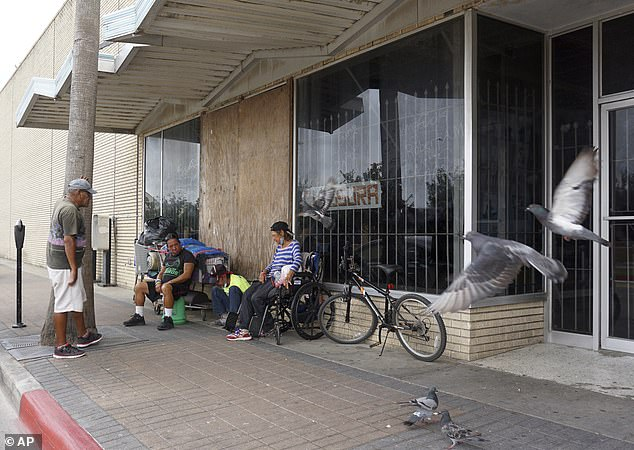 Homeless are seen in downtown Brownsville, Texas, on May 15