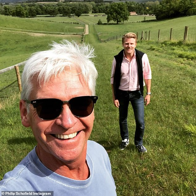 Hitting back: Phillip Schofield, 58, was forced to defend himself against a cruel troll who mocked his use of the word 'mate' when out on a walk with a friend on Saturday