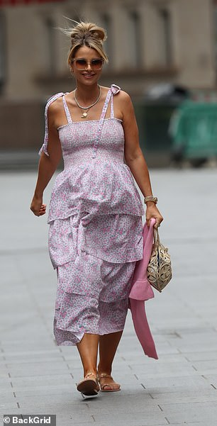 Serene: the 34-year-old dress was designed in a soft pink and white pattern and had flowing straps, tied at the top