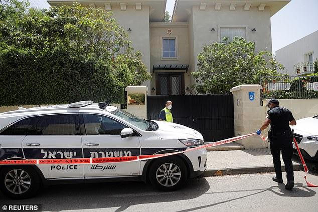 An Israeli policeman cordons off an area near the house of China's ambassador to Israel, Du Wei, in Herzliya, near Tel Aviv, Israel