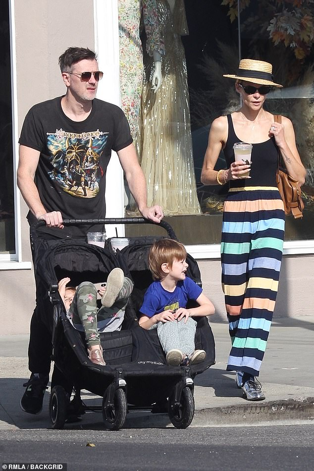 Family life: the couple with their two sons at the farmers market in West Hollywood in 2019