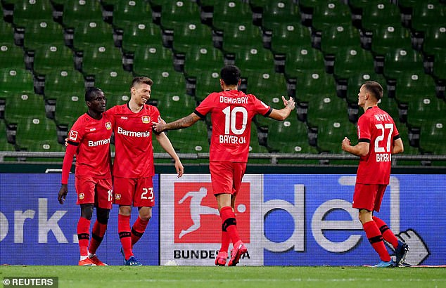 Leverkusen players celebrate after Weiser (second from L) scores his team's third goal