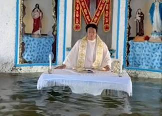 WATCH: Parishioners Sit in Boats as Priest Delivers Final Mass Inside Flooded Church in Philippine Village that is Sinking Into the Sea